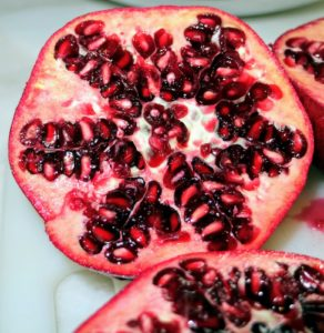 Red-purple in color, the pomegranate fruit husk has two parts: an outer, hard pericarp, and an inner, spongy mesocarp, which comprises the fruit's inner walls and seeds. The number of seeds in a pomegranate can vary from 200 to about 1400 per fruit.