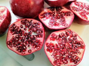 Once the pomegranate, Punica granatum, is split it reveals clusters of juicy, gem-like seeds on the inside called arils.