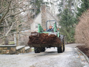 Here's Phurba driving the John Deere filled with nutrient rich compost made in the back fields of the farm. With a good, mild break from the snow, we decided it was the best time to start composting the beds.