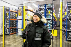 Here I am standing in front of the gates to the seed storage area. It is bitterly cold in the Vault and blowing fans that circulated cold air made it feel even colder. As you can see, there are aisles and aisles of tall shelving to house all the boxes of seeds. (Photo by Michael Poliza)