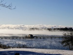 This is the Northeast Harbor Fleet Dock. Past the dock is lots of sea smoke, or steam fog, which is formed when very cold air moves over warmer water.