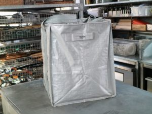 I keep gray ones in my greenhouse. Each bag measures approximately 20-inches wide by 20-inches long by 24-inches tall.