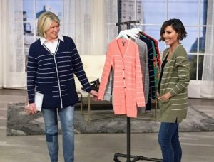 QVC host, Amy Stran, is wearing the cardigan in fern.