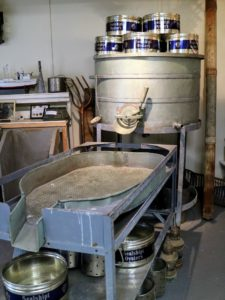 The process of cleaning the oyster meat hasn't changed much at all. This is an old machine used to wash and drain the meat before it was packaged into cans.