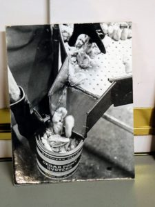 Here is an old photo showing the oyster meat falling into one of the tins before being sealed and shipped.