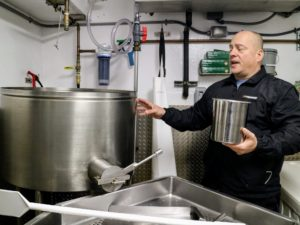 Shucking Supervisor, Alan Sharkany, explains how the shelled oyster meat is tossed nto a skimmer tank filled with water and then spun with air in order to separate any dirt, sand or shell particles, which fall through the holes in the tub's grate.