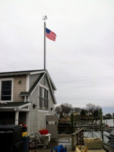 Here is a flag flying high above the docks. To learn more about Norm Bloom & Son Copps Island Oysters, and how to shuck oysters, go to their web site. http://www.coppsislandoysters.com/