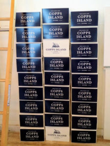 One wall of the store is decorated with boxes showing the company's logo. With more than 12-thousand acres of oyster farms, Norm Bloom & Son Copps Island Oysters sells at least 20-million oysters wholesale every year.