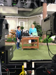 Here I am with QVC host, Jane Treacy - this photo was taken from behind the cameras. There are always multiple cameras involved in these shows so viewers can see items from a variety of angles.