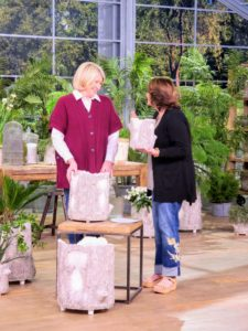 Here I am with QVC host, Jill Bauer. We're talking about my Faux Bois Planters, which come in three sizes - a nine-inch, a 14-inch and a 19-inch.