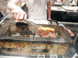 Here we see the king crab from Finnmark being grilled on a Hibachi. The king crab is one of the world's largest crustaceans. After leaving the waters off Russia, these crabs continue to invade the Norwegian arctic coast. This one is being grilled in butter emulsion.