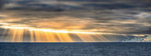 This gorgeous sunset photo was taken at Bransfield Strait, a body of water about 60-miles wide and 300-miles long between the South Shetland Islands and the Antarctic Peninsula.