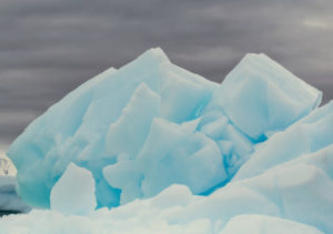 More spectacular details in this iceberg, or ice mountain. These giant icebergs are all pieces of freshwater ice that have broken off glaciers or ice shelves and are now floating freely in the open waters.