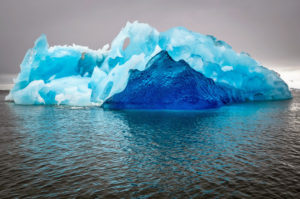 Here is an abstract photo showing the icebergs and ripples in the waters below.