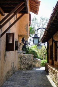 There are many narrow, cobble-covered alleyways lined with lanterns and shuttered limestone walls. The village also features Mediterranean-style restaurants, and quaint shops featuring the diverse craftwork of local artisans.
