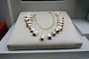 Here is an old tribal necklace. These ritual and utilitarian objects demonstrate the cultural evolution of the region.