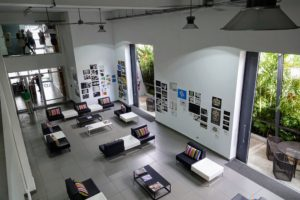 This urban campus was originally a cupcake factory until it was transformed and renovated into a beautiful, clean and airy institution. Here is the main lobby with high ceilings and lots of seating.