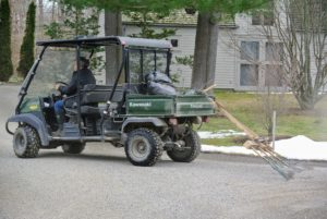 """Meanwhile, everyone is pitching in to get the farm clean and ready for my Easter guests. Here's Fernando """"dragging the roads"""". My farm has four-miles of carriage road, and all the gravel must be leveled properly for good coverage and drainage. We attached rakes to the back of our all-terrain-vehicle to make this task easier and faster."""