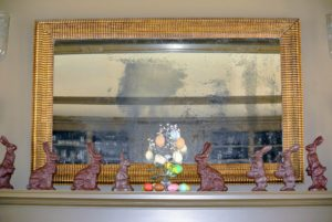 Lots of faux chocolate bunnies decorate the mantel in my Brown Room.