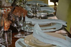 """Laura set my """"bird room"""" dining table with drabware and pastel green - so pretty for spring. The linen napkins are rolled simply and placed on each setting."""