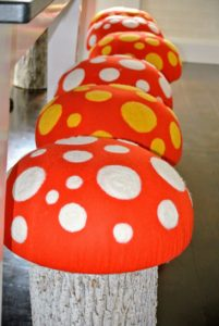 "Laura brought out these wonderful toad stools – I made these on ""The Martha Stewart Show"" – everyone loved these stools. And the children love them here in the Tenant House kitchen."