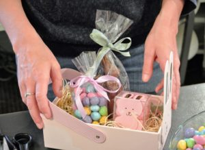 "And then she adds a chocolate bunny and a bag of caramel M&Ms. Each child will get a box filled with candy and then use the box for collecting eggs – maybe even a ""golden egg""."