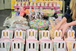 Once all the candy was prepared and packaged, Shqipe began filling the boxes - first with a bedding of Easter grass.