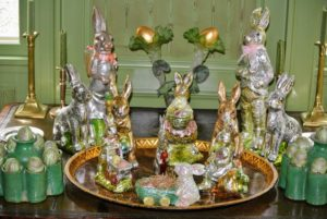 In my Green Parlor, many of these look like old fashioned chocolate bunnies wrapped in foil, but they're really ceramic bunnies covered in foil. They may not be edible, but they will last much longer.