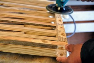 Once everything is complete, he covers the screw holes and sands down the entire structure so it is smooth.