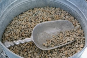 Pea gravel, so named because the pieces are pea-sized, is available at garden centers and comes in different colors.