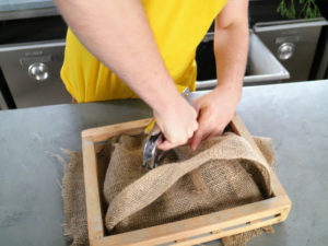 He adds staples to three sides, so it is very secure. The rhipsalis will sit in the burlap pocket very nicely.
