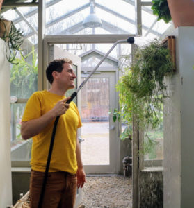 Ryan gives the plant a good drink of water. Even though rhipsalis is a pretty tolerant cacti, its best not to let it dry out or especially get over-watered. It should only be watered when it feels dry to the touch. Rhipsalis plants are tropical and subtropical, so be sure to also protect them from the cold.