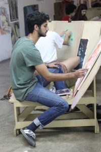 Here is a student using an easel as he paints. (Photo provided by Chavon: School of Design)