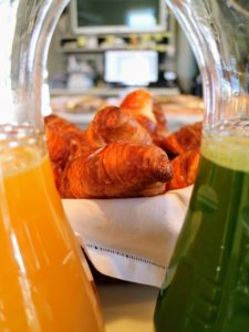 I love this photo of the warm croissants between the juice pitchers.