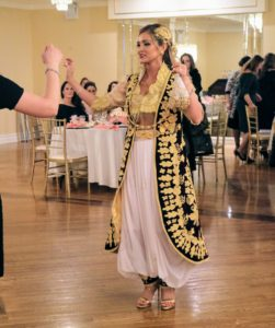After dancing for a few minutes by herself to show her guests the beautiful black, white and gold costume, family and friends joined her on the dance floor.