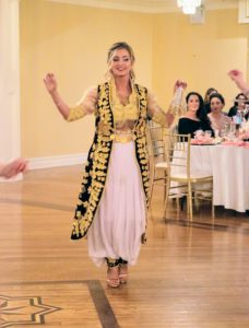 Shqipe entered the room and danced to traditional Albanian music - and gently waving her handkerchief.