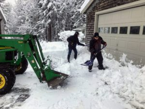 Fernando and Rick shovel mound after mound into the bucket until the driveways and footpaths are clear.