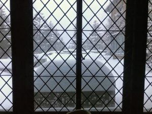 "This is one of my favorite views – through a leaded window in the dining room to the large ""cracked ice"" terrace."