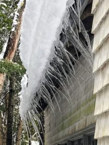 This photo shows the icicles that formed under the roof. The icicles froze in the wind and are several inches long.