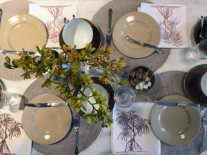 On this morning, my longtime housekeeper, Laura, set another very pretty setting at my kitchen counter. Kevin took this photo from above looking down at the plates, cups and centerpiece.