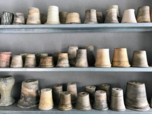 Inside the headhouse, the work center of a greenhouse, I store many pots including this selection of Guy Wolff clay pots. I love Guy's pottery, and have hundreds and hundreds of his handmade vessels. http://www.guywolff.com/