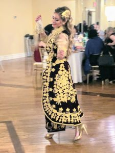 This costume has a different Shelvare to match the dark skirt. She is also wearing real and faux gold coins, or lira, around her neck.
