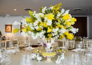 The vessel for this arrangement is a circa 1795 Derby porcelain vase with yellow ground and a botanical print - all part of a dessert service. It is perfect for these daffodils, mimosas, sweet peas and tulips. (Photo by BFA Photographer, Joe Schildhorn)