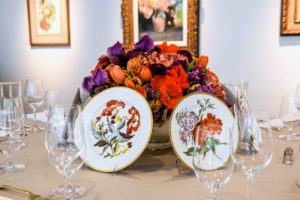 This fanciful and fun arrangement is done in a Derby porcelain botanical dinner and dessert service - one tureen surrounded by five plates. The blooms include poppies, iris, tulips, anemones and ranunculus. (Photo by BFA Photographer, Joe Schildhorn)