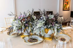 This porcelain set is a Worcester crested faux marble dessert service. Some of the flowers include dusty miller, muscari, clematis and artichokes. (Photo by BFA Photographer, Joe Schildhorn)