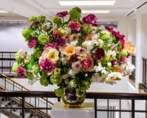 On each side of the book cover was a gorgeous arrangement of flowers filled with poppies, ranunculus, sweet peas, and viburnum. (Photo by BFA Photographer, Joe Schildhorn)