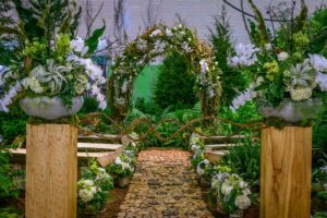 Here is a diverse collection of plants, mosses and trees nestled in a lush landscape for a fairy-tale inspired wedding in the woods display. It was designed by Robertson's Flowers & Events. (Photo by Rob Cardillo for PHS)
