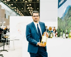 Stephane Rouveyrol of VIP Wines in France - makers of Château d'Arche wines shows three-liter double magnum of 2005 Château d'Arche Grand Cru Classe Sauternes. He surprised me with this gift bottle. (Photo by Brandon Bibbins of DRINKS)