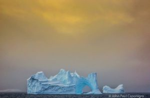 This 2014 photo shows how John Paul waited for one iceberg to emerge from another on Detaille Island, Antarctica.