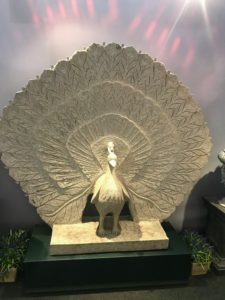 Here is another peacock sculpture with its tail of feathers extended.